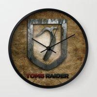 tomb raider Wall Clocks featuring Tomb Raider by Liquidsugar