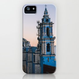 A blue colonial church taken from a rooftop at sunset iPhone Case