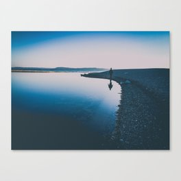 serene reflection walking by the water Canvas Print