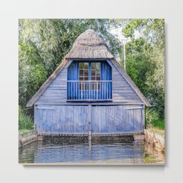 Thatched boat house on the river Metal Print