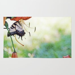 tiger swallowtail on tigerlily Rug