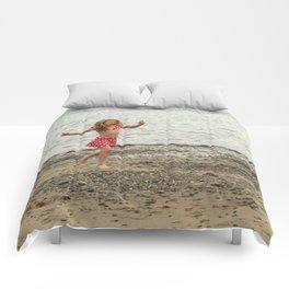 girl on the beach Comforters