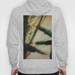 Blurred hands with plants, dancers Hoody