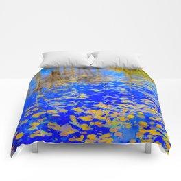 Golden leaves, shimmering pond Comforters