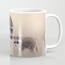 Raccoon family in the grassland looking out Coffee Mug