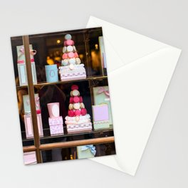 Beautiful colorful tasty macaroons cakes sweets and presents in the boxes display in window at the  Stationery Cards
