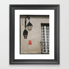 The little devil on the wall Framed Art Print