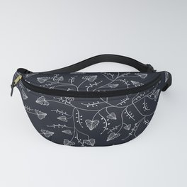 Delicate leaves on a black background . Fanny Pack