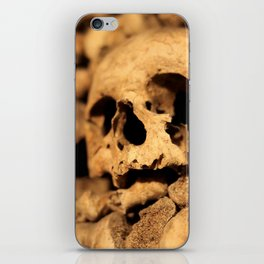 Skulls in the catacombs of Paris, France. iPhone Skin