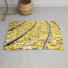Tram tracks full of yellow leaves in autumn Rug
