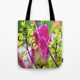 Pink tulip against yellow flowers Tote Bag