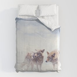 Two coyotes walking  in the winter snow Comforters