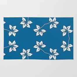 Simple White Flowers on Blue Rug