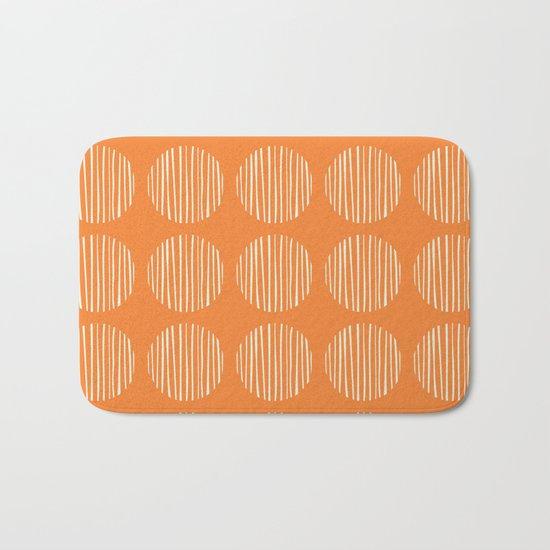 Circle stripes on orange Bath Mat
