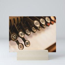 Close-up of antique cash register keys Mini Art Print