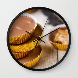 I - Homemade peanut butter cups on a rustic table Wall Clock