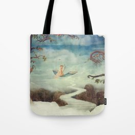 Little girl on the swing in the  fantastic country in sky  Tote Bag