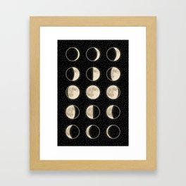 shiny moon phases on black / with stars Framed Art Print