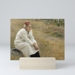 man seating white dress Mini Art Print