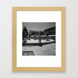 Black and white road kicking around the office Framed Art Print