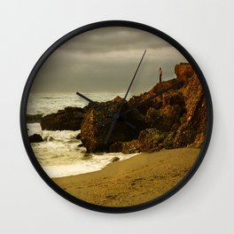 Alone on the rocks Wall Clock
