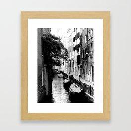 Gondolas along a venetian canal Framed Art Print