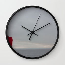 Red Flag & a Person, A Wall Clock