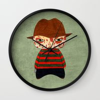 freddy krueger Wall Clocks featuring A Boy - Freddy Krueger by Christophe Chiozzi