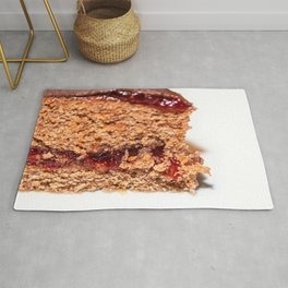 Detail of slice of chocolate cake with strawberry jam filling Rug
