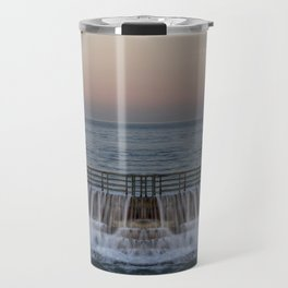 A reflected panorama of a seawall as a wave washes over it in La Jolla, San Diego, California Travel Mug