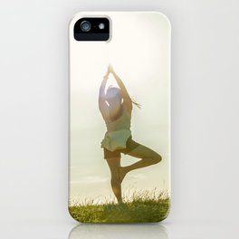 Yoga tree pose on a hill iPhone Case