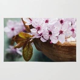 spring flowers for spa and aromatherapy over wooden background Rug