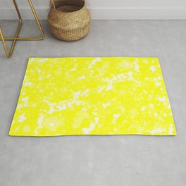 A bright cluster of yellow bodies on a light background. Rug
