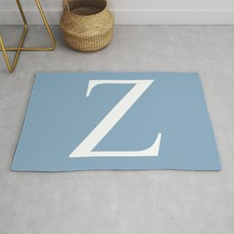 Letter Z sign on placid blue background Rug