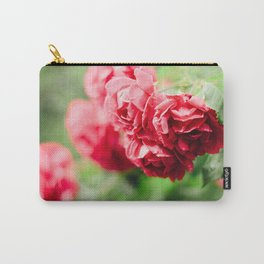 Buds of tea roses hanging in clusters on bushes Carry-All Pouch