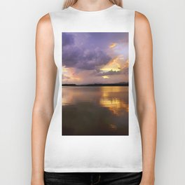 Panoramic. Sunset at the lake after the storm. End of the summer. Biker Tank