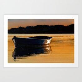 Rowing boat at sunset. Art Print