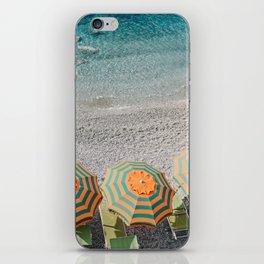 Umbrellas on the beach iPhone Skin