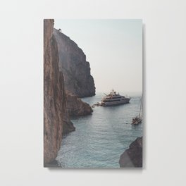WHITE - AND - BLACK - BOAT - ON - SEA - NEAR - BROWN - ROCK - FORMATION - PHOTOGRAPHY Metal Print