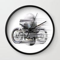 cafe racer Wall Clocks featuring SKULL AND CAFE RACER by Joedunnz