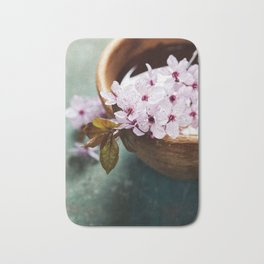 spring flowers for spa and aromatherapy over wooden background Bath Mat
