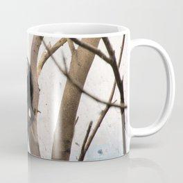 Black Monkey on sky-blue wall. Coffee Mug