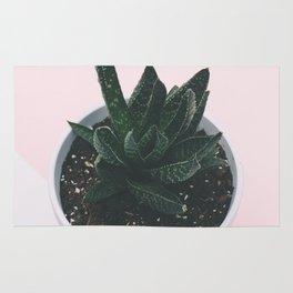 simple plant Rug