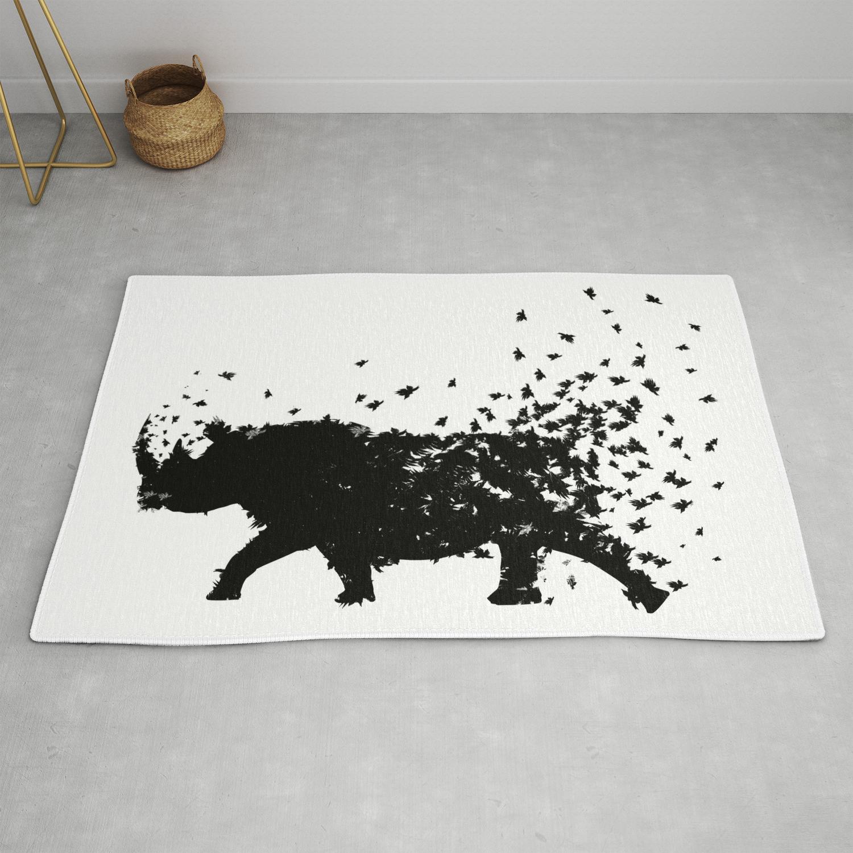 Rhinos Fading Away Rug By Newkid Society6