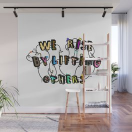 We rise by lifting others Wall Mural