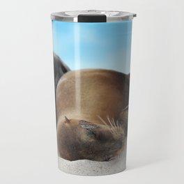 Sea lions family sleeping together on beach Travel Mug