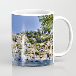 Symi island in Greece. Traditional houses. Sunny day with blue sky and sea. Coffee Mug