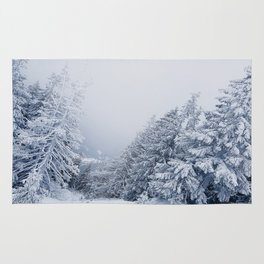 snow covered trees Rug
