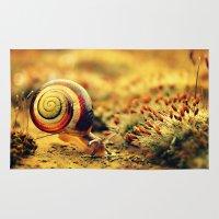 snail Area & Throw Rugs featuring Snail by Alexandra Baker