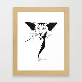 Mean look with a gentle heart Framed Art Print